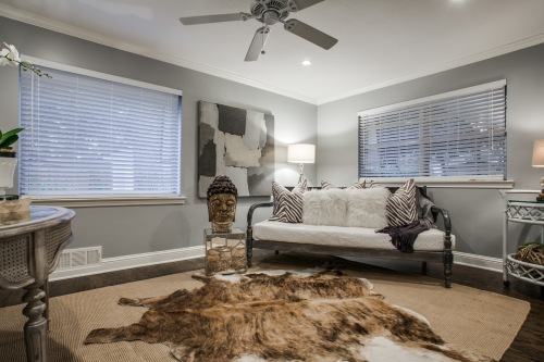 1212 N. Oak Cliff knows how to incorporate a cowhide rug into a chic room.